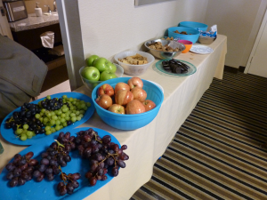 bowls of fruit, cookies, and crackers in the Con Suite