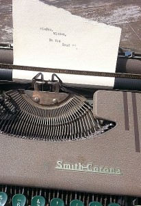 "a brown manual typewriter with a sheet of paper that reads ""WisCon, WisCon, Do You Read?"""